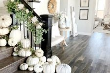 styling the staircase with white pumpkins, greenery and fresh white blooms is very refined and gorgeous