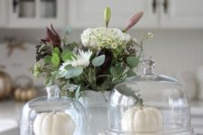white pumpkins on the table and in a cloche, a lush and neutral floral arrangement in a vase for fall decor