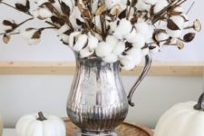 white pumpkins, pinecones and a cotton arrangement in a silver jug for elegant and chic fall decor