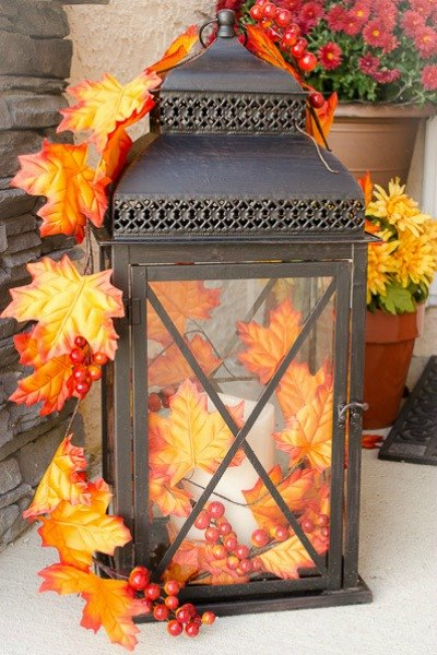 A garland made of faux autumn's leaves and berries is a really easy way to decorate a lantern and to add a touch of fall here and there.
