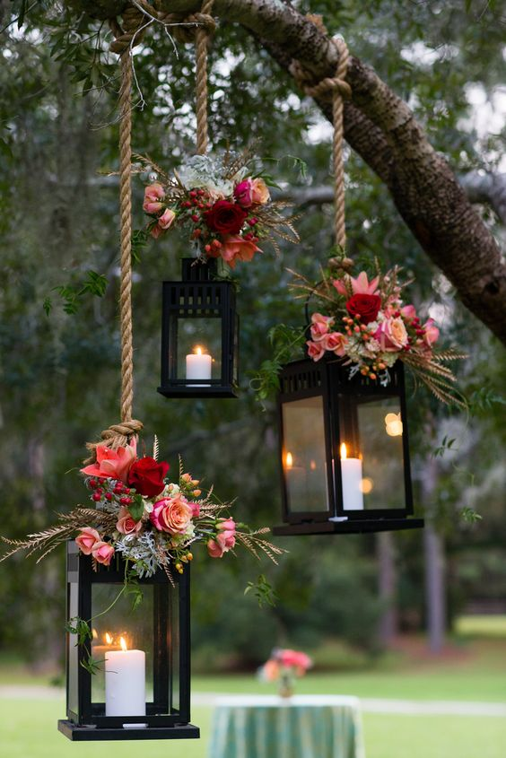 It's a quite popular idea to use lanterns with candles for wedding decor. Little bouquets of fall blooms on top of them would be great way to personalize them.