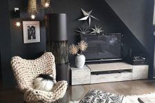 a butterfly chair covered with a chunky knit piece looks fantastic, it's veyr cozy and welcoming