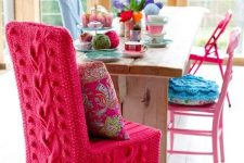 a chair covered with hot pink knit looks super bright and cozy and will make your space very welcoming