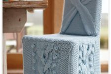 a chair covered with powder blue knit is very chic and cool and will finish off a vintage or rustic space