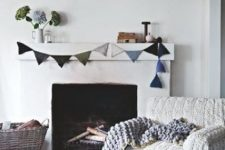 a chair with a white chunky knit cover, a chunky knit blanket and some pillows make the living room winter-inspired