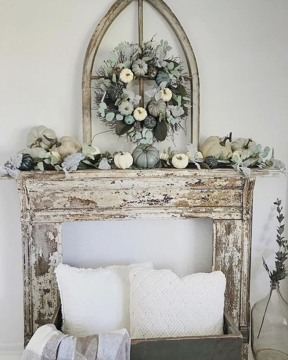 a chic neutral and pastel fall mantel with a faux pumpkin and greenery wreath and the same on the mantel