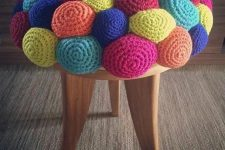 a colorful crochet stool with a ball-like seat is a fun and whimsy idea to rock in your space