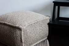 a cozy grey crocheted ottoman is a cool piece to make your space winter-ready