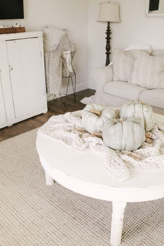 a crochet blanket and some large heirloom pumpkins on it are amazing for fall home decor
