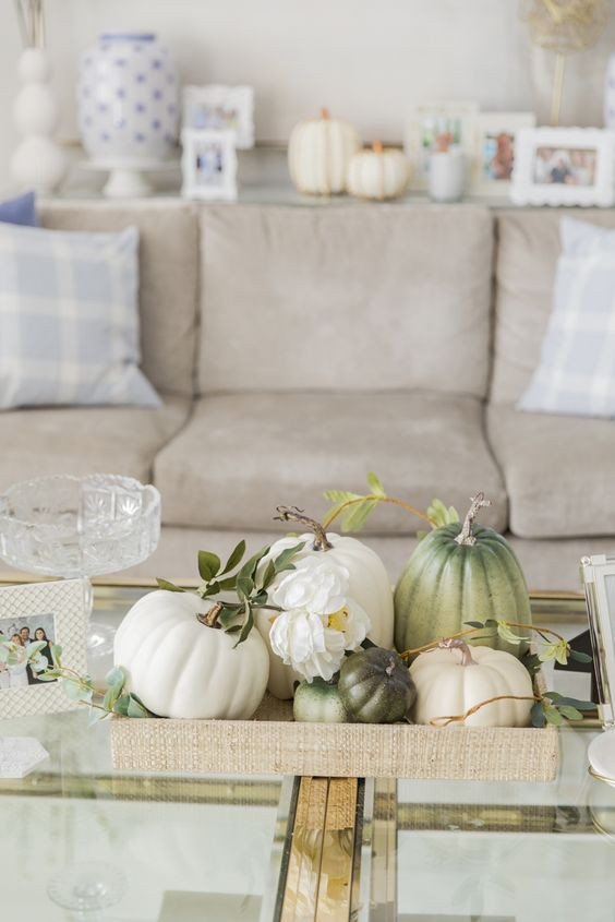 a fabric tray with natural pumpkins and white blooms for a neutral farmhouse coffee table