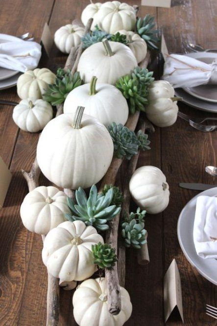 a fall centerpiece with branches, white pumpkins and succulents is easy to make