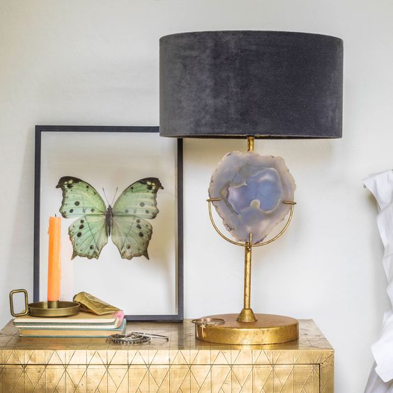 a fantastic agate table lamp with a gold base, a large agate insert and a lavender velvet lampshade for a wow effect