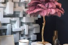 a fun ostrich feather table lamp with a base reminding of an ostrich leg is a glam and quirky idea to go for