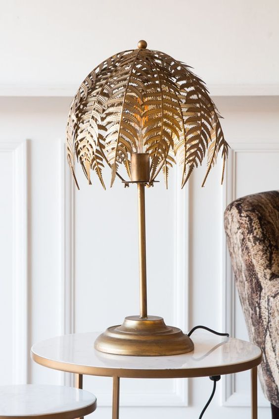 a gold fern leaf table lamp will bring a refined touch to the space and make it very sophisticated