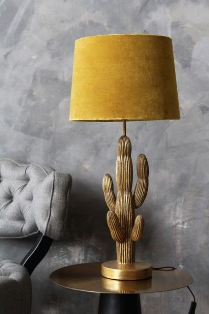 a gorgeous gold cactus table lamp with a mustard velvet lampshade is a bold sophisticated solution for a modern space