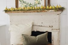 a harvest fall mantel with moss, pears and a cool sign plus muted pillows on wooden boxes