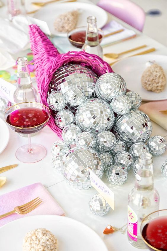 a hot pink cornucopia with disco balls instead of veggies is a fantastic glam decor idea