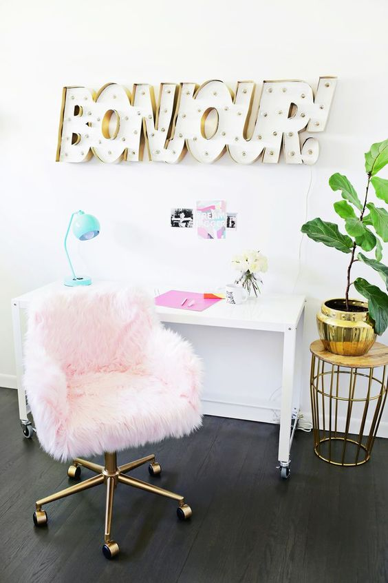 a light pink faux fur chair with brass legs is a great solution for a glam feminine home office