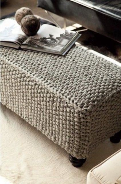 a long grey knit ottoman with vintage legs is a cool piece to cozy up your room and make it welcoming