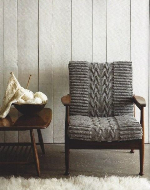a mid century modern chair finished off with cozy grey knit is a lovely idea to make your space welcoming