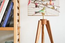 a quirky copper bird cage table lamp with lots of faux birds is a fun and cheerful idea for any space