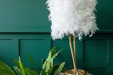 a refined and quirky table lamp of white ostrich feathers and gold leg-shaped base is a very fun idea