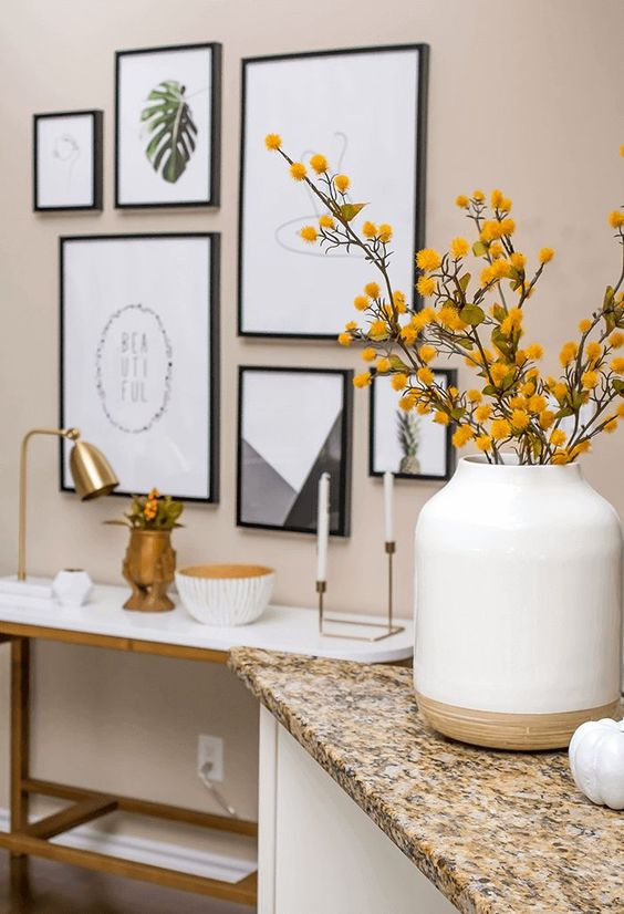 a stylish fall decoration - an oversized color block vase with branches with leaves and blooms