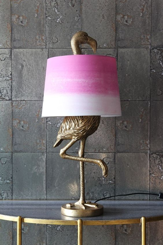 an antique bronze flamingo table lamp with a tie-dye pink lampshade for a touch of color to the space