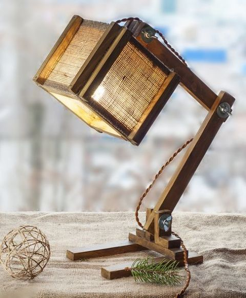 an industrial wood and burlap table lamp with a cubic lampshade is a cool and non-traditional solution