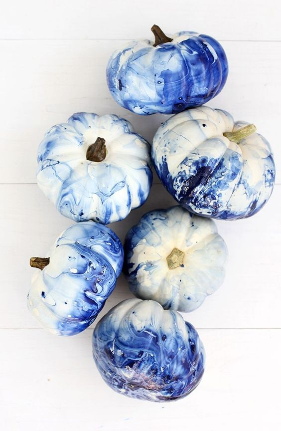 bold blue marble pumpkins are easy to DIY and will give a modern feel to your space easily