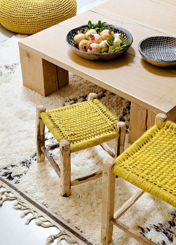 bright mustard crocheted stools and an ottoman are cool and comfy furniture pieces with plenty of color