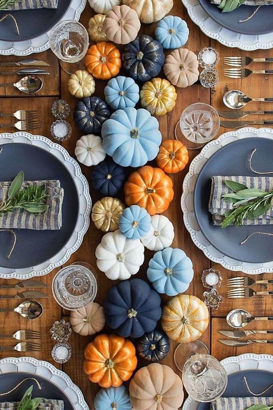 colorful painted pumpkins for a cool table runner, fresh twigs for each place setting and some candles
