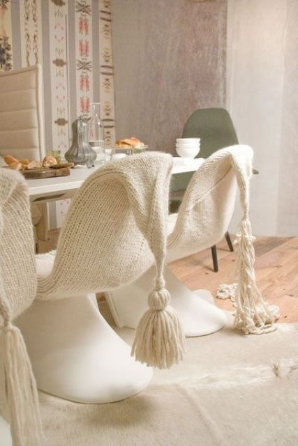 cover your usual dining chairs with white knit or crochet with large tassels to make them cute and very cozy for sitting