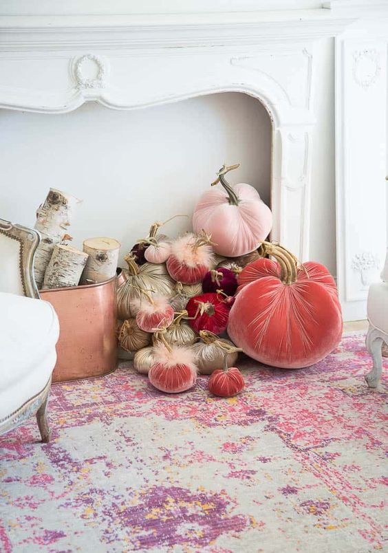 gold, blush and coral velvet pumpkins with faux fur will make your space very refined and very chic