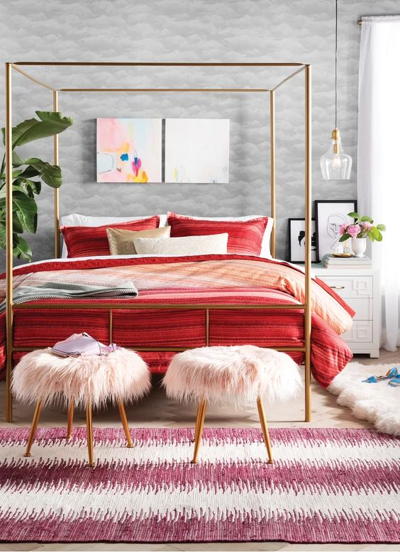light pink faux fur stools with gold legs are a cute and romantic addition to a bedroom and they bring a bit of color