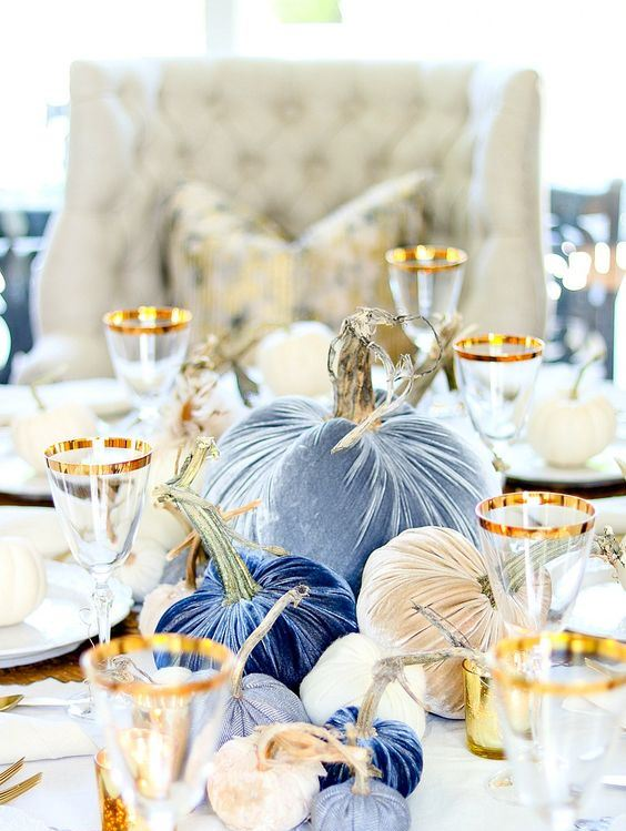 navy, blue, blue printed and tan velvet pumpkins are a refined and chic fall centerpiece to try