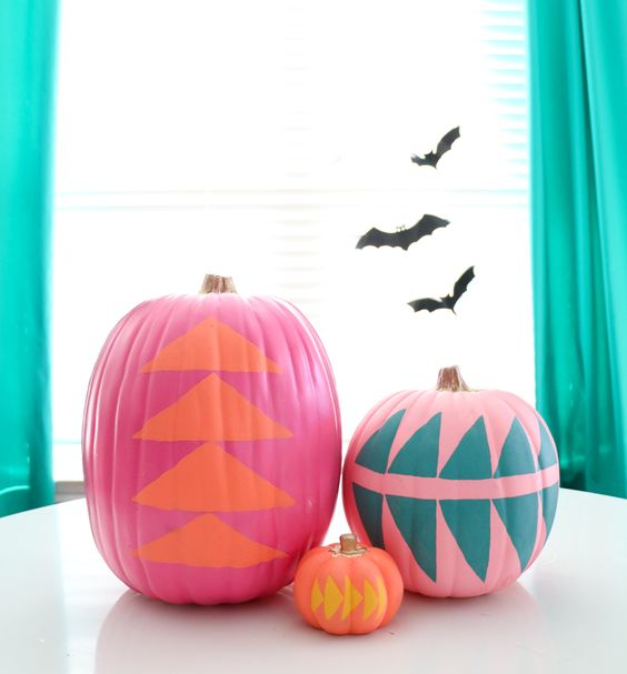 pink, orange and hot pink pumpkins with geometric stencils are a very bold and cool decoration