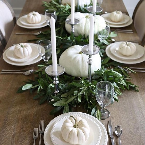 simple and elegant fall party styling with fresh greenery, white pumpkins and tall candles