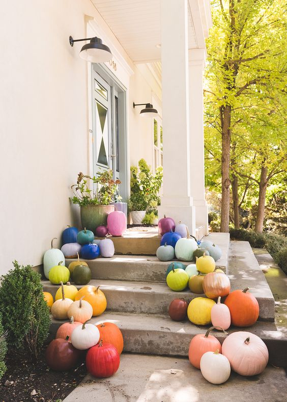 super colorful pumpkins placed on your porch will give it a fall feel and a colorful touch