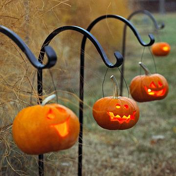 Hang small glowing jack-o-lanterns along the outdoor path.