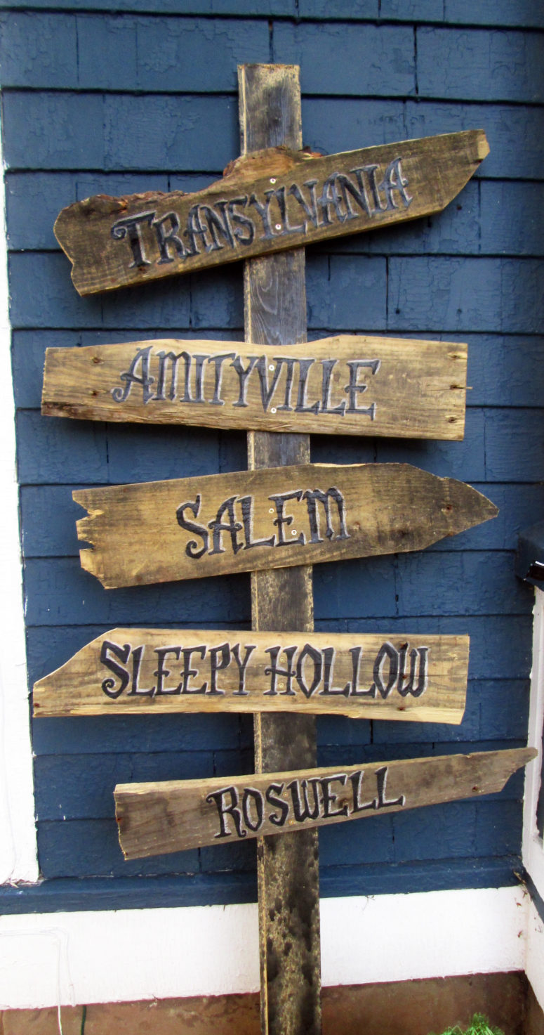 A rustic sign would show the most scary way for your guests.