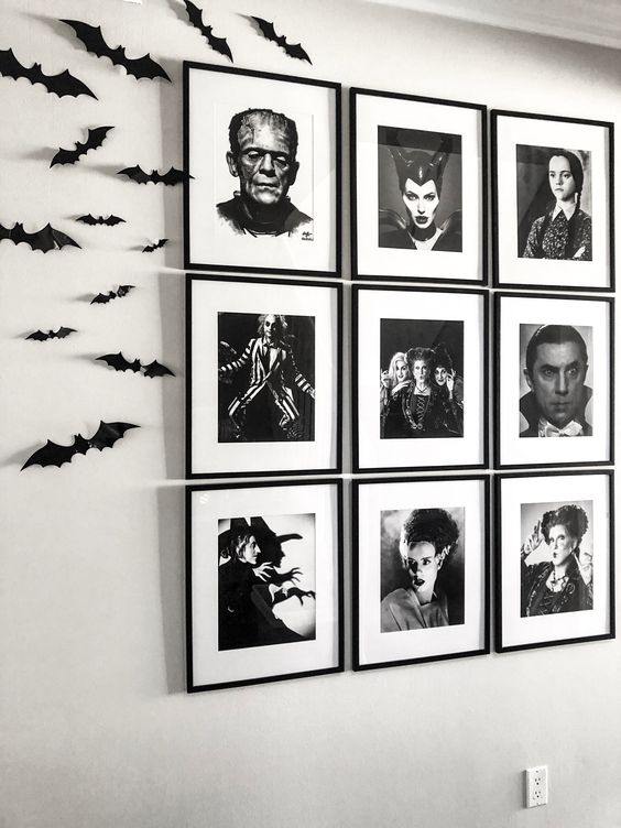 a black and white grid gallery wall and black bats on the wall will give a cool Halloween feel to the space