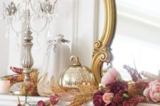 a gold mercury pumpkin, mauve and pink blooms and dried herbs will make your mantel very refined and Thanksgiving-like