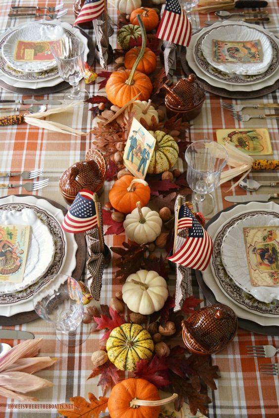 a refined vintage Thanksgiving tablescape with dried leaves, nuts, acorns, pumpkins, vintage porcelain and vintage cards