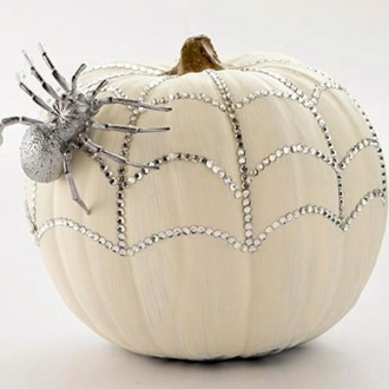 a sparkling pumpkin with rhinestones and a a silver spider for a glam feel is a pretty solution for Halloween