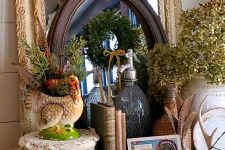 a vintage Thanksgiving mantel with dried berries, blooms, green hydrangeas, a turkey planter and some cards and books