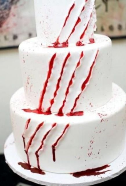 a white cake with scratches and bloody dirpping is a perfect solution for any kind of Halloween party
