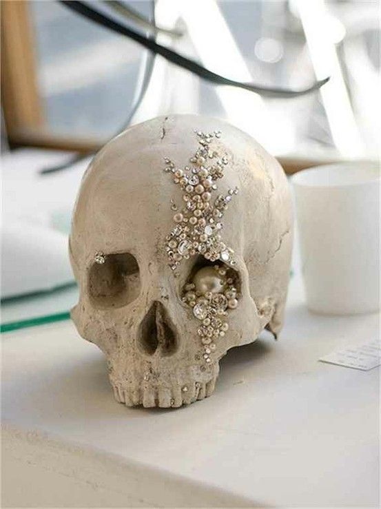 an embellished skull with pearls, rhinestones and sequins for a glam feel is a beautiful solution for a white Halloween party