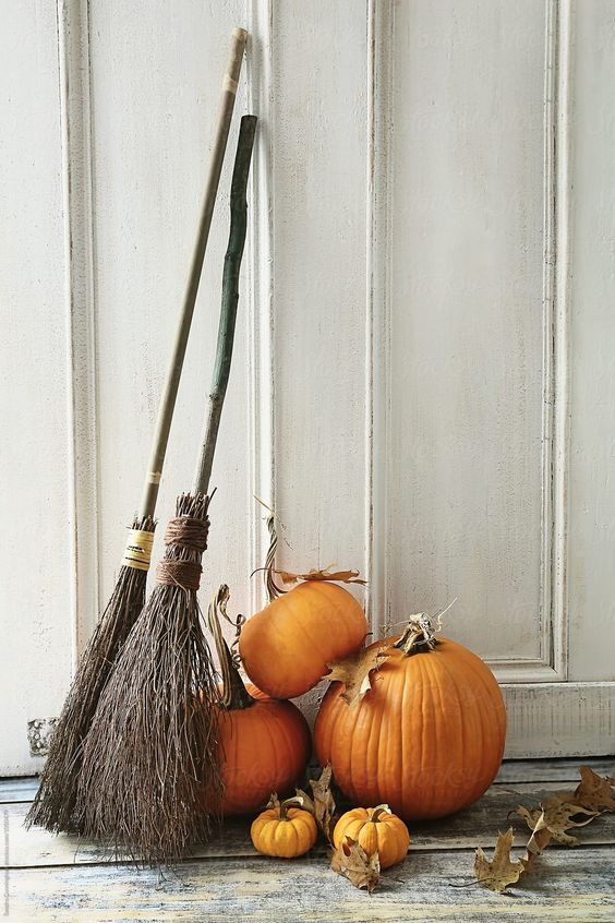 brooms, leaves and pumpkins are cool rustic decor for Halloween and they are easy to compose