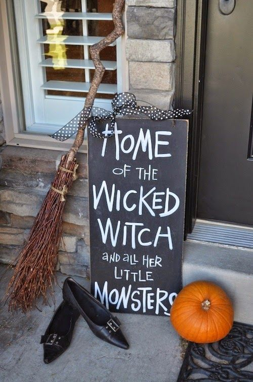 easy front porch Halloween styling with a pumpkin, a chalkboard sign, a broom and witches' shoes